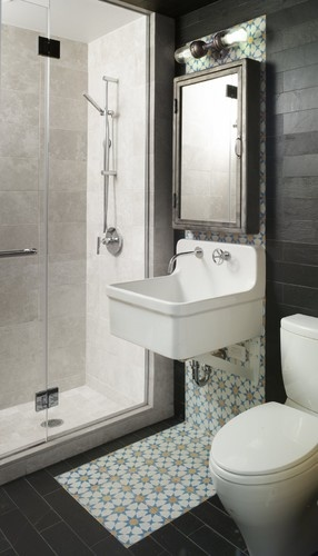 black and white slate tiles in the guest bathroom act as a neutral shell to the vibrant moroccan cement tile backsplash that reaches all the way under the