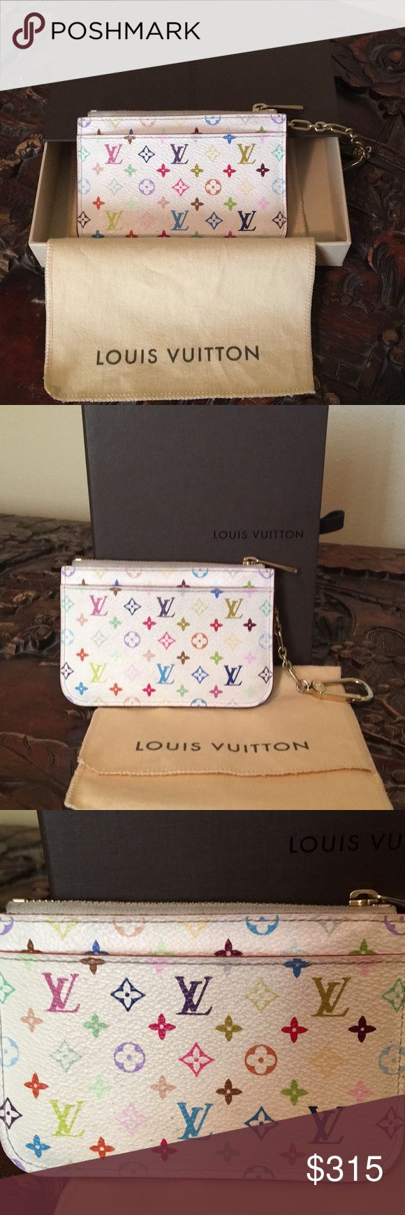 Louis Vuitton Multicolor Cardholder Louis Vuitton multicolored card holder  Retired Collector's piece.   Preloved but minimal signs of wear.  Zipper in good working order. Can clip to inside of your bag. I clip it to my jeans belt loop and slide in back pocket when I dont want to take my large bag. Will fit ID, credit cards and cash. Also has an outside pocket for additional items.   Item Code is CA4140  Will include dust bag and box  Please do not ask what my lowest price is. Use the offer…