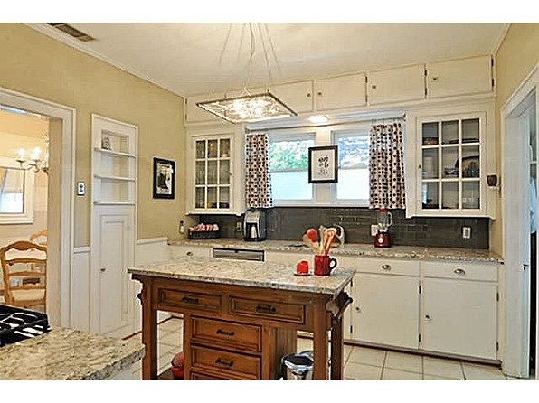 Renovated kitchen with granite countertops & island, stainless steel appliances & glass tile backsplash.: Stainless Steel Appliances, Glasses Tile, Small Kitchens, Renovation Kitchens, Glasses Cabinets, Tile Backsplash, Old Cabinets, Granite Countertops, Cabinets Islands