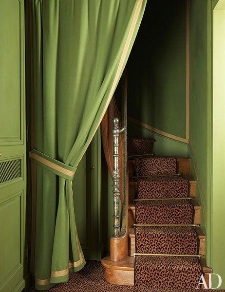 Pierre Bergé -- A leopard-print runner animates a secret stairway.