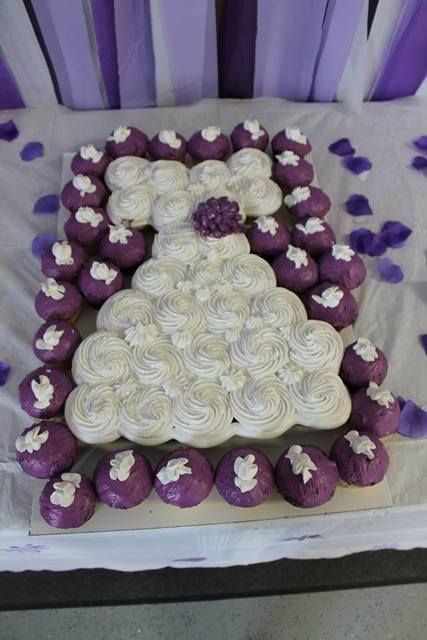 Purple and white cupcake cake at a Love Is... Bridal Shower Party!  See more party ideas at CatchMyParty.com!
