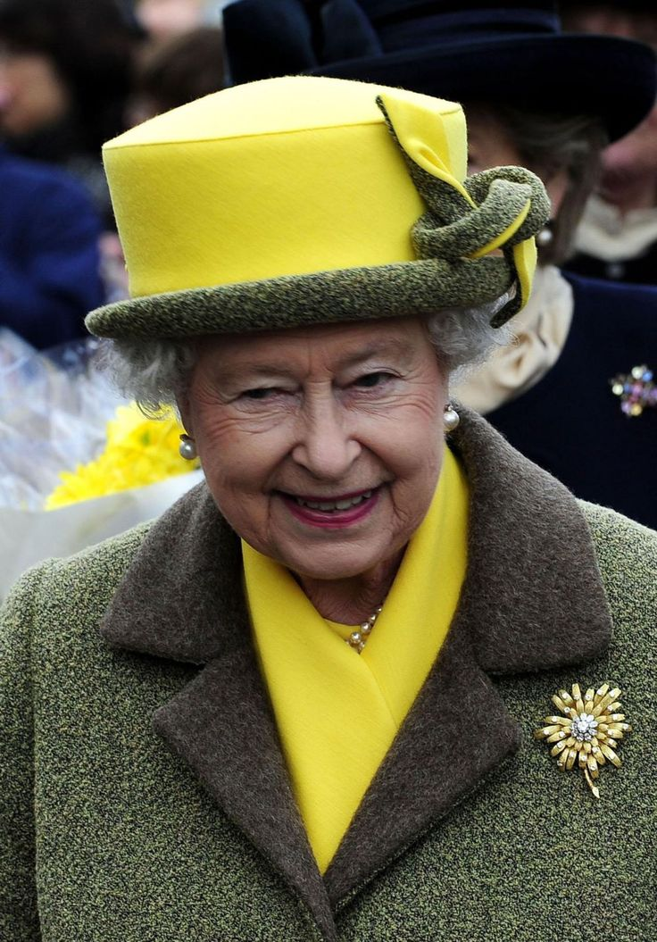 Queen Elizabeth wearing her Frosted Sunflower Brooch.