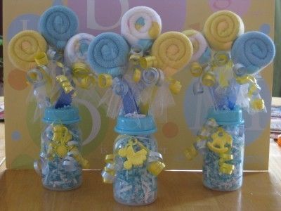 Rolled up washcloths on baby utensils with baby bottle for Baby bottle decoration ideas