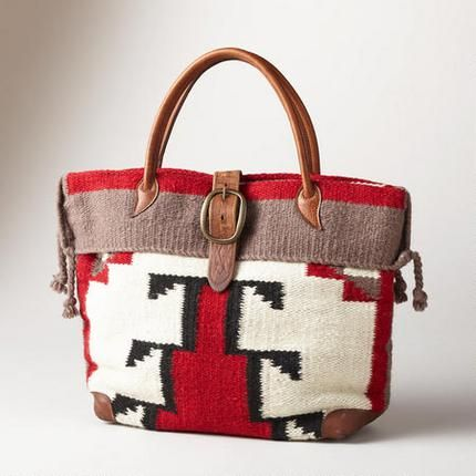 """Timpanogos Travel Bag Our serape-striped wool bag, big enough for a weekend, has a wool fabric bottom, handles and buckled closure, . Nylon lining with two full-length zip pockets. Made in the USA. 19""""W x 6""""D x 13""""H. $248"""