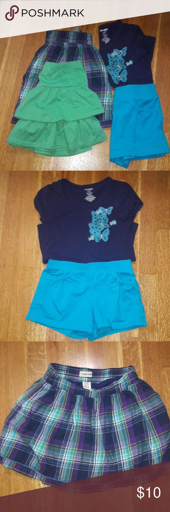 Girls size 7 bundle 3 bottoms and 1 top 1 skirt size 7/8 Cheroke plaid purple,blue, light green 1 skirt Gymboree green size 7 1 short size 7/8 blue 1 top Old Navy size small All in good condition, some worn once Gymboree Bottoms Skirts