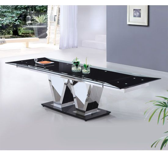 Features: • Sophisticated glass extendable dining table• Modern mixture of black centre and clear sides glass top • High quality toughened safety glass provides a durable, hard weari...