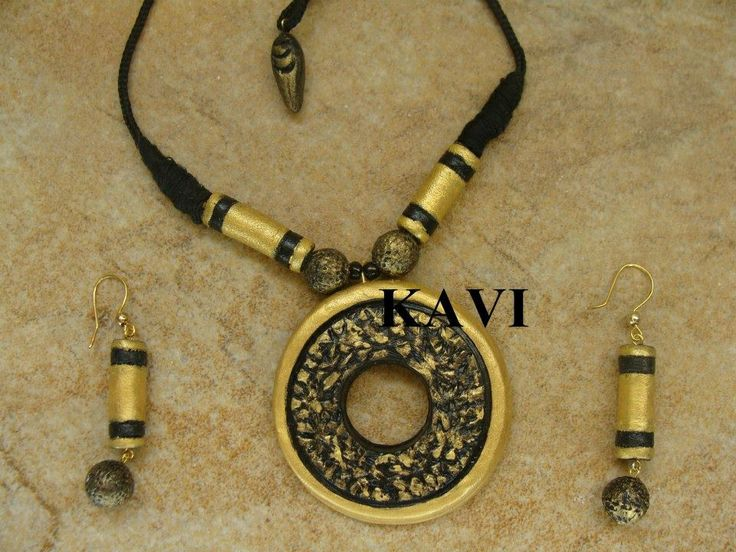 Circle shaped terracotta pendent painted on gold & black acrylic paint https://www.facebook.com/KavisTerracottajewellery