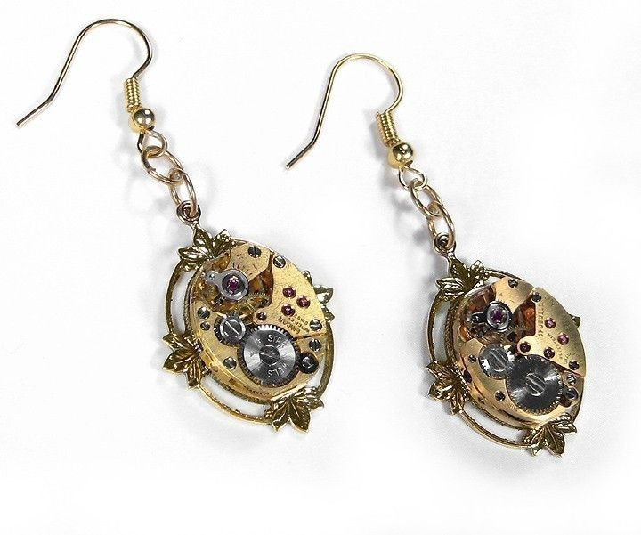 Steampunk Earrings Vintage Gold Ruby Jeweled Watch Movement Earrings Lotus Leaf Setting  STUNNING - Steampunk Jewelry by edmdesigns. $125.00, via Etsy.