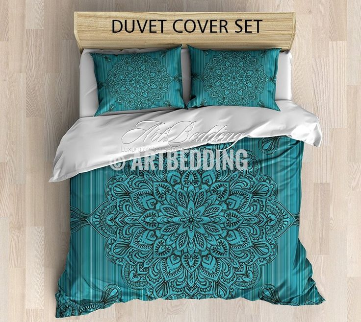 This gentle design is a combination between traditional mandala design and a beautiful turquoise vintage texture background. And when you look at it as if the mandala and the other design elements are engraved on the background . This all gives you this boho chic vintage effect that is the new modern trendin interior. It is in warm earth colors to complete this feeling. 3-piece DUVET COVER SETIncludes: 1 duvet cover / NO duvet insert/ and a set of 2 pillow coversOur Reversible down Duvet…