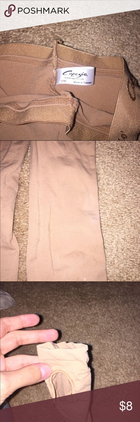 Tan and pink dance tights Capezio pink and tan tights pink are footed and the tan has the open foot tan has slight tearing but will be good for practices Capezio Other