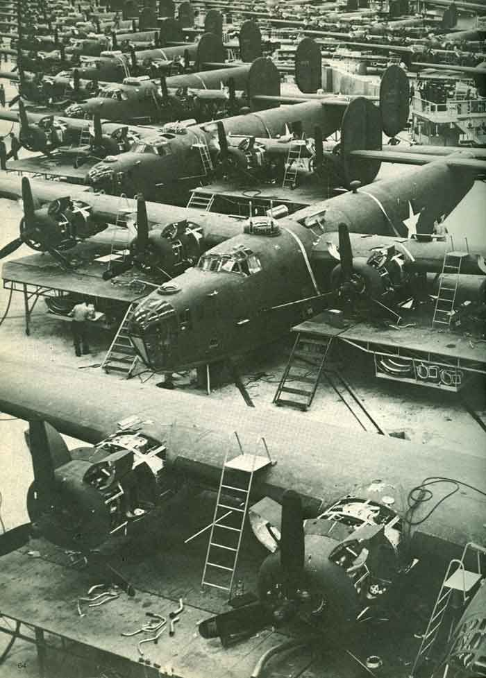 B-24 Liberators in final assembly at the one of several enormous factories( possibly Fort Worth ) in the U.S purpose built to produce the type.