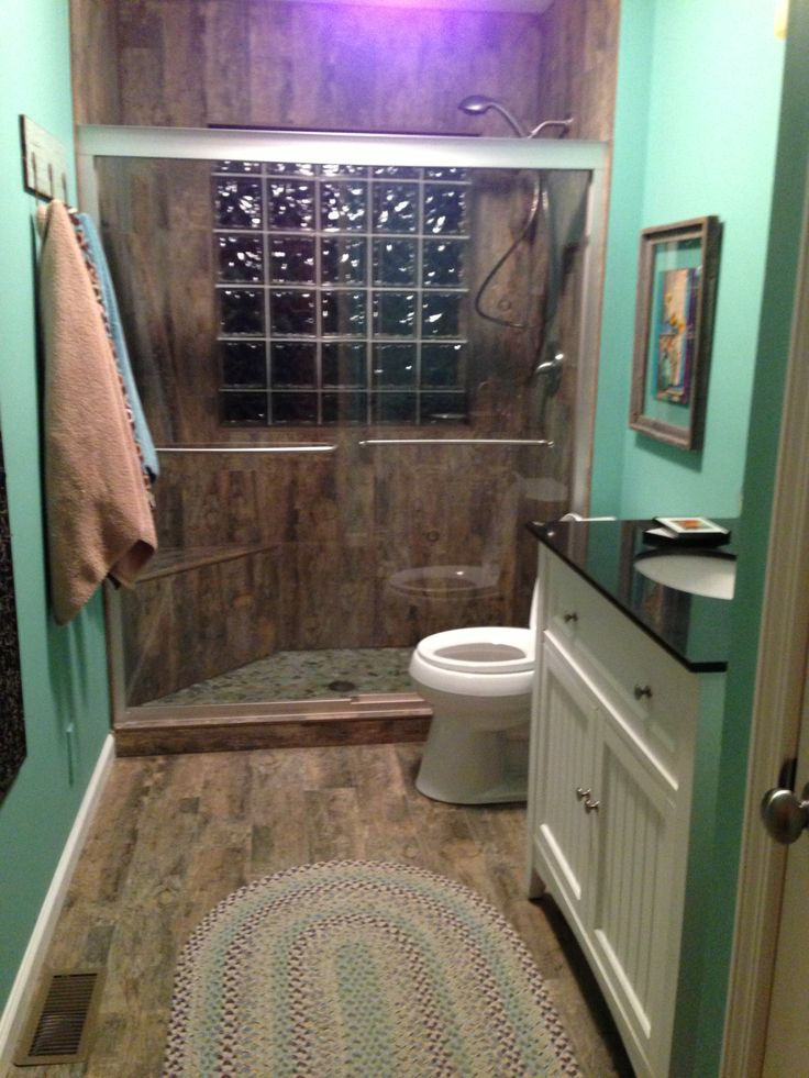 Porcelain tile that looks like old barn wood on the floor for Cabin shower tile ideas