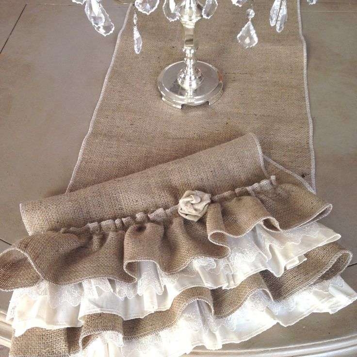 Burlap Ruffled Table Runner with Lace and Fabric Flower by ShabbieChicHome on Etsy https://www.etsy.com/listing/266110377/burlap-ruffled-table-runner-with-lace