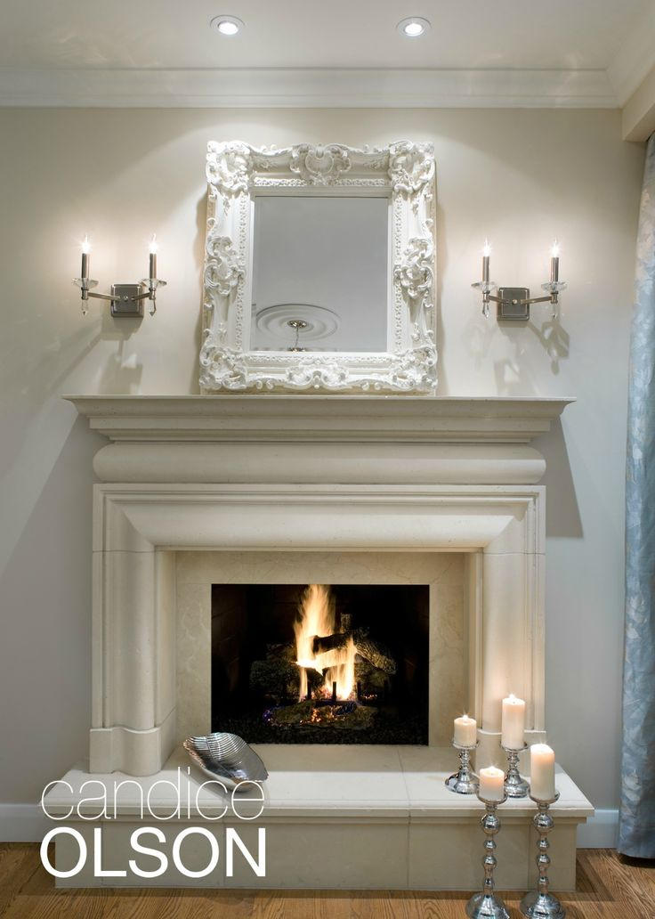 A beautiful cast-stone surround and hearth look like hand-carved limestone and set the tone of old-world elegance this client wanted.  The hearth is also roomy enough to perch on for after-dinner conversations-- maybe for roasting some marshmallows? #candiceolson