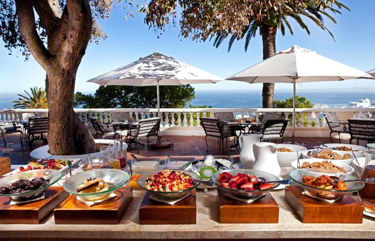 The garden breakfast spread at Ellerman House, overlooking Bantry Bay in Cape Town.