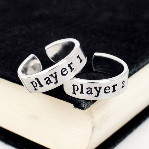 This Player 1 and Player 2 friendship ring set is great for best friends or couples that want to show their bond. Stamped on the end of each ring