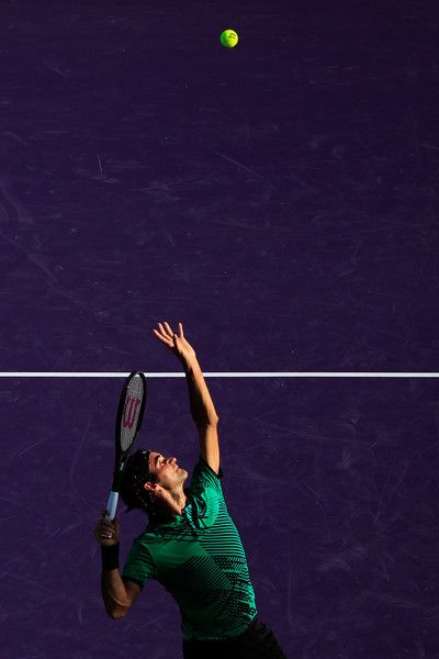 Roger Federer Photos Photos - Roger Federer of Switzerland serves to Roberto Bautista Agut of Spain during Day 9 of the Miami Open at Crandon Park Tennis Center on March 28, 2017 in Key Biscayne, Florida. - 2017 Miami Open - Day 9