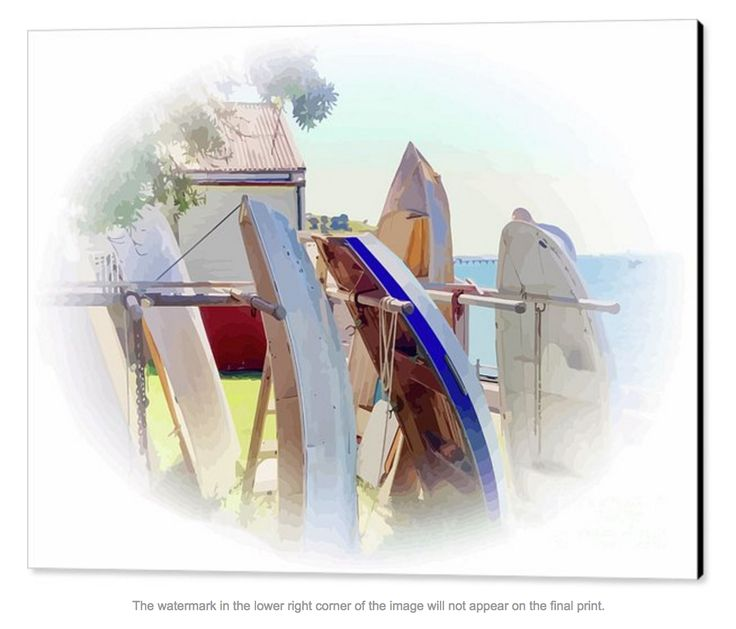 """A  morning walk along the tree-lined foreshore of Auckland Harbour and I spotted this delightful stack of curved dinghies. I love the  morning """"glow"""". That's an old boat shed in the background."""