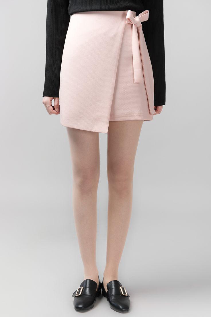 #mixxmix Ribbon Wrap Mini Skirt (BWSJ) Cute and sleek, this mini skirt has that trendy wrap style with ribbon fastening. #mxm #hideandseek #has #365basic #bauhaus #99bunny#koreanfashionstyle #girlsfashion #lovelywoman #kstyle #koreangirls #streetfashion #twinlook #dailyoutfit #styling