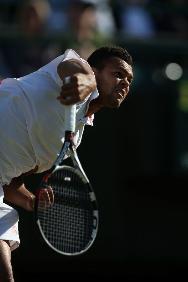LONDON, ENGLAND - JUNE 30: Jo-Wilfried Tsonga of France serves during his Gentlemen's Singles third round match against Lukas Lacko of Slovakia on day six of the Wimbledon Lawn Tennis Championships at the All England Lawn Tennis and Croquet Club at Wimbledon on June 30, 2012 in London, England. (Photo by Clive Rose/Getty Images)