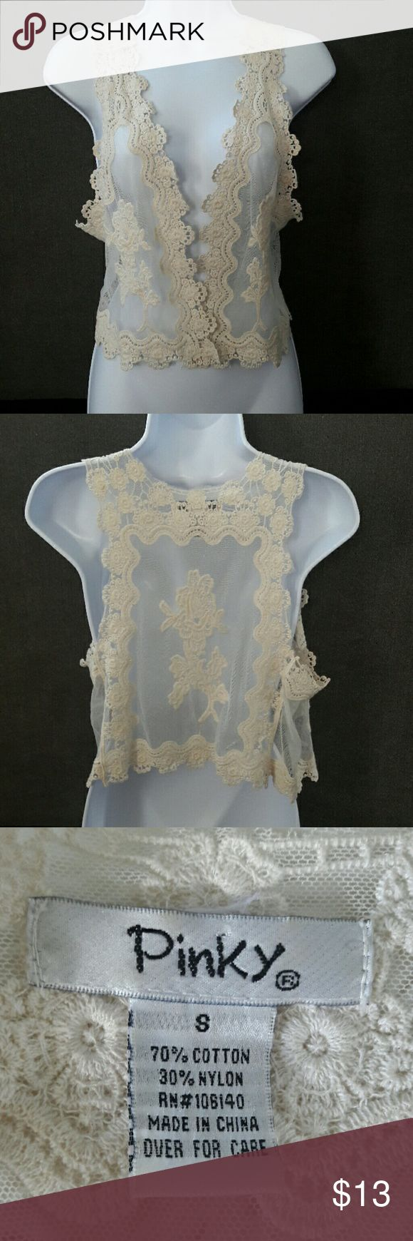 Off-white lace vest/throw Never worn. 70% cotton 30% nylon Pinky Tops Tunics