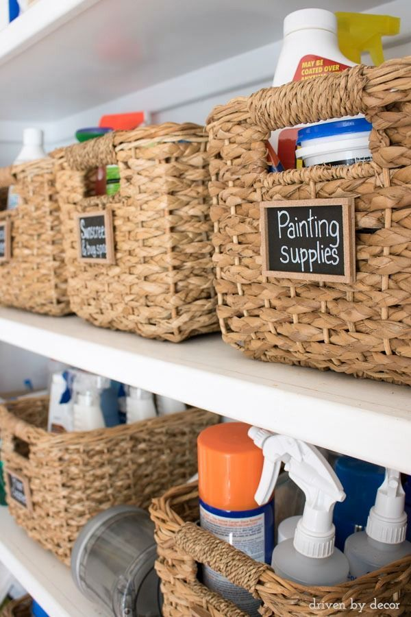 Woven baskets with cute mini chalkboards were used to whip this mess of cleaning and painting supplies into shape! #kitchen #kitchens #organization #organize #organizing #baskets #pantry