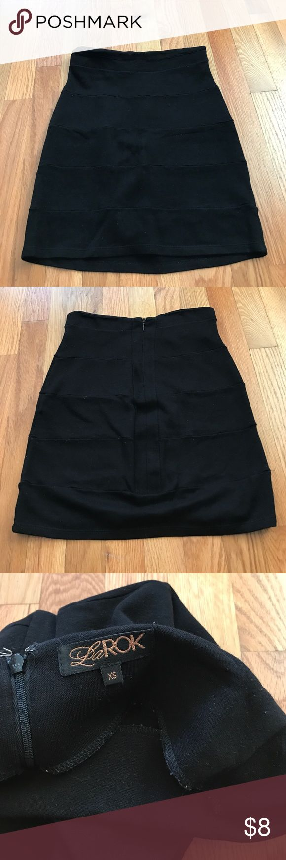 La Rok Bandage skirt Black form fitting high waist bandage skirt. Bought brand new from Nordstrom. It does have a little pilling and is not in brand new condition though it does have plenty of life left. It looks super cute with a fun top tucked in. Skirts Mini