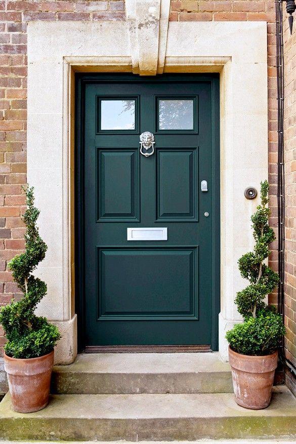 Forest green front door.