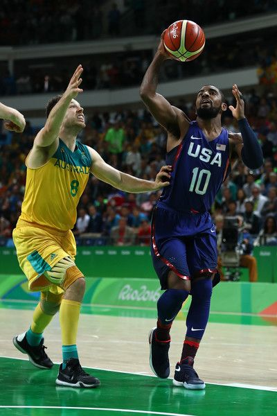 Matthew Dellavedova Photos - Kyrie Irving #10 of United States shoots against Matthew Dellavedova #8 of Australia during a Preliminary Round Basketball game between Australia and the United States on Day 5 of the Rio 2016 Olympic Games at Carioca Arena 1 on August 10, 2016 in Rio de Janeiro, Brazil. - Basketball - Olympics: Day 5