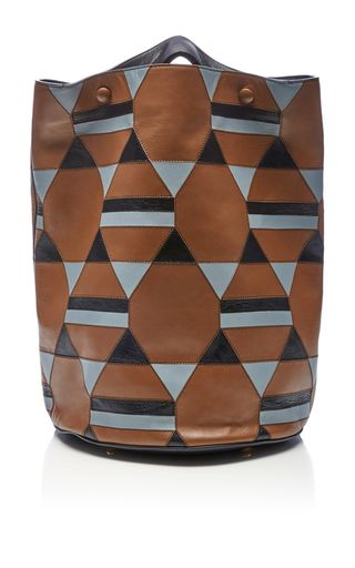 This shoulder bag by **Marni** is rendered in calf leather and features a geometric pattern and adjustable nylon strap with a detachable wallet.