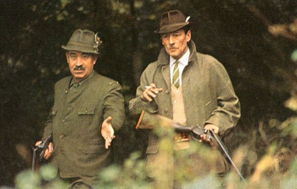 """Former enemies Adolf Galland and Robert Stanford Tuck chat while  on a hunting trip during a lull in the production of the movie """"The Battle of Britain."""" Both men were wing commanders and top aces within  their respective air forces during the war. They became friends after the war and Tuck became godfather to Galland's son."""