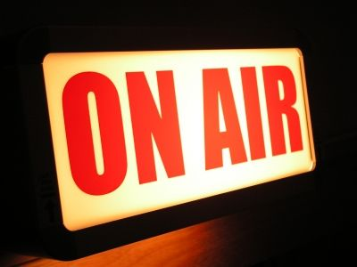 on air sign as prop