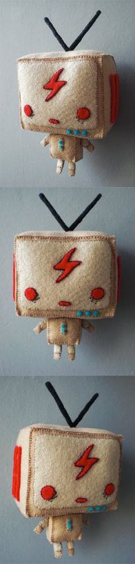 This character's name is TV Nino, originally it was a papertoy designed by Eric Wijanarta; an illustrator and also founder of Deathrockstar. This plush's hand sewn circa 2008