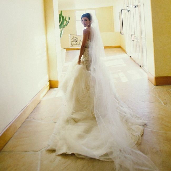 The bride upped the drama of her draped lazaro gown with a for How much is a lazaro wedding dress