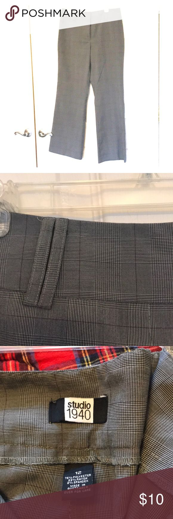 Grey ladies dress pants. Grey ladies dress pants. No pickets in back. Wide belt loops or faux belting in back (see picture).  Wide leg 10 inches. Inseam 31 inches crotch to hem. Worn but in excellent condition no rips stains or tears.  Comes from a non smoking home Studio 1940 Pants Trousers