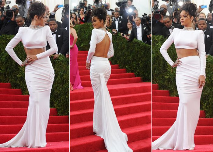 Skin is in! Rihanna rocks a Stella McCartney draped train, backless crop, Jacob & Co. diamond choker and wild atop hairstyle.