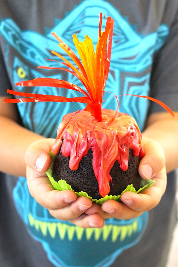 Easy and kid friendly erupting volcano cupcakes, perfect for any dinosaur playdate or party idea! Best of all, no special cake decorating skills required.