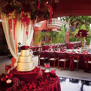 Red Reception With Hanging Flowers And Gold Cake
