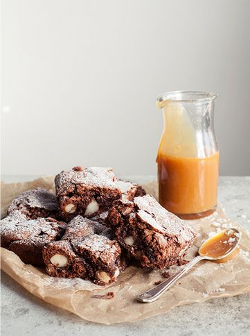 chocolate and macadamia brownies with salted caramel sauce.