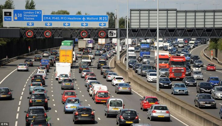 Motorists start to queue in heavy traffic on the M25 between junction 12 and 13 near Egham...