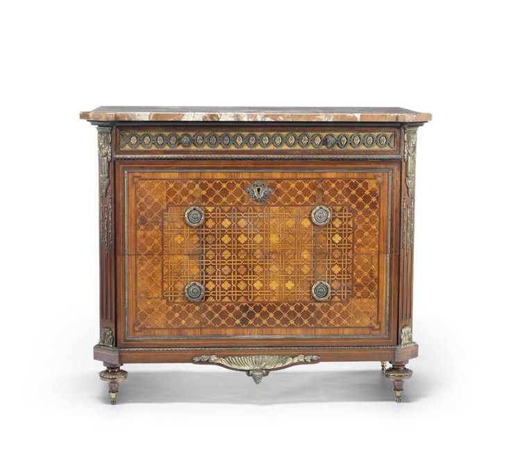 A French late 19th century Louis XVI style ormolu-mounted sycamore, amaranth and tulipwood marquetry and parquetry commode