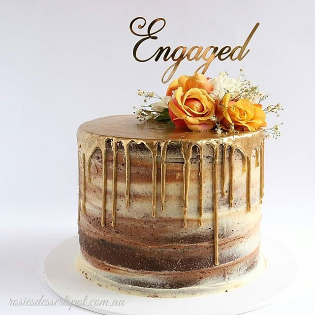 A tall naked cake I made for a very special couple! May their lives be filled with love and happiness together forever more x)  Featuricng our fancy Engaged gold mirror topper #engagement #wedding #engagementtopper #weddingtopper #caketopper #lasercut #nakedcake #engagement cake #floralcake #cakedecorating #cake #acrylictopper