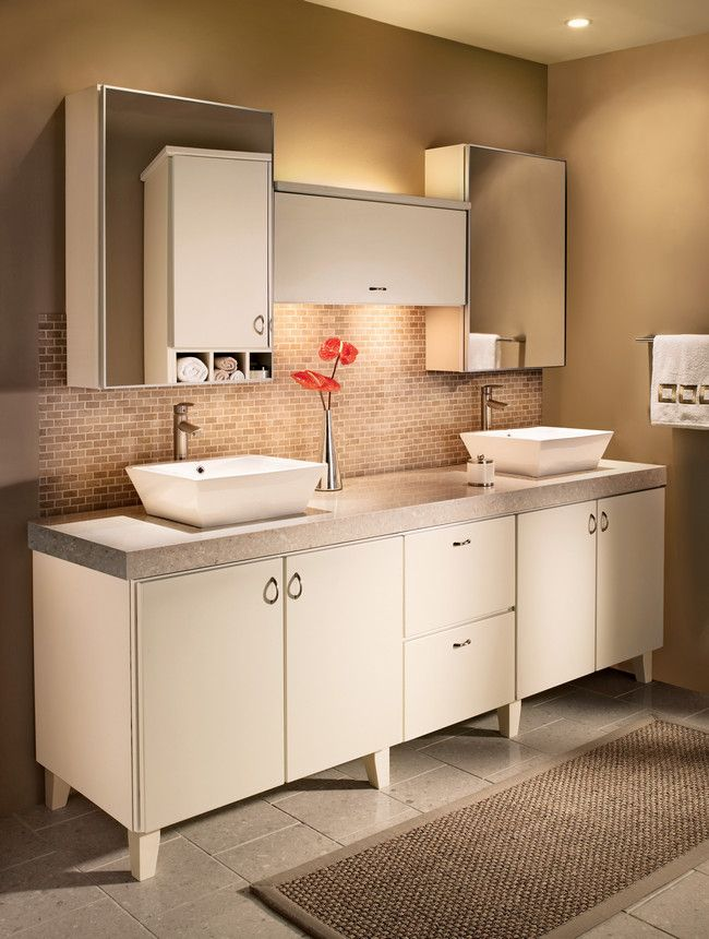 kraftmaid cabinets tapered legs and slab doors in cream thermofoil create an elegantly modern bathroom for two