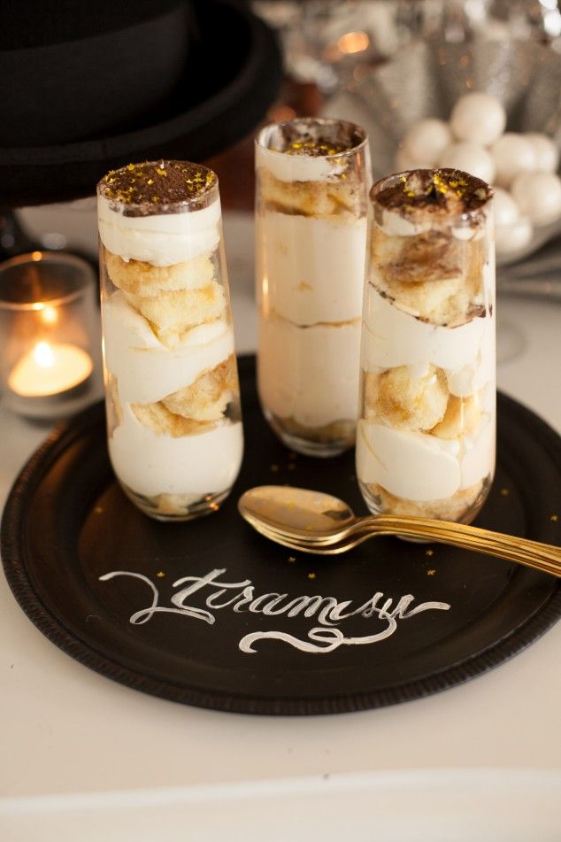 Shortcut tiramisu in champagne glasses makes a fancy New Year's Eve dessert, especially when served on DIY chalkboard trays