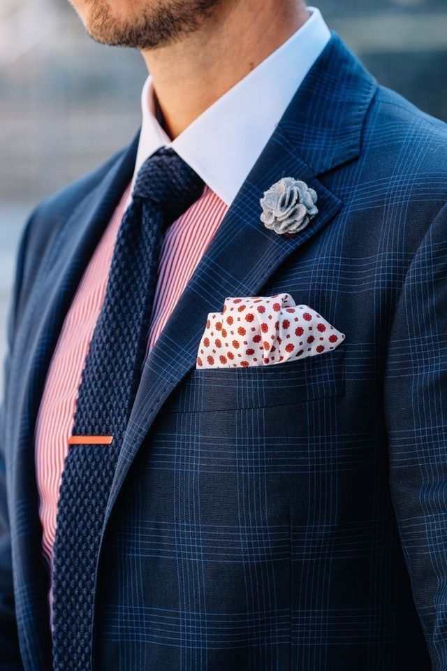 62acc71255dd Crisp accessory organization with a blue plaid blazer white with red polka  dot pocket square gray lapel flower red striped shirt with a white collar  navy ...