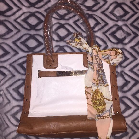 Aldo Tote Bag With Removable Scarf Beautiful golden accents! Removable Satin Scarf! Please see first picture for slight dark discoloration, price reflects the front discoloration ALDO Bags Totes