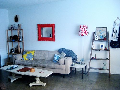 A comfy, contemporary couch paired with the vintage coffee table makes an eclectic statement.