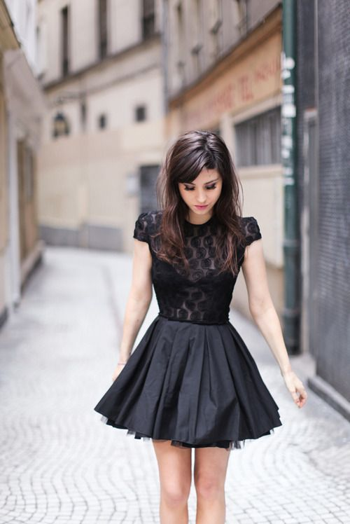 love this lbd: beautiful skirt, love the material and flare of the pleats; and bodice in sheer pattern is beautiful, little cap sleeves make it more elegant and versatile -- The Little Black Dress.