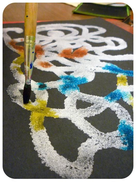 Salt painting. Make a glue design on dark paper, coat with salt, gently touch the salt with food coloring on a wet paintbrush, and the color spreads. Fun art project for kids!