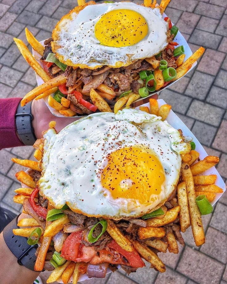 Döner saltado -- sautéed onions tomato and red peppers mixed with french fries and Doner Kebab topped off with a fried egg and aji sauce. [1080  1350]